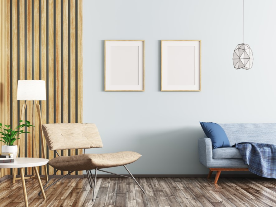 Serene_Entry_way_blue_feature_wall_wooden_striped_wall_blue_couch_pillow_throw_white_table