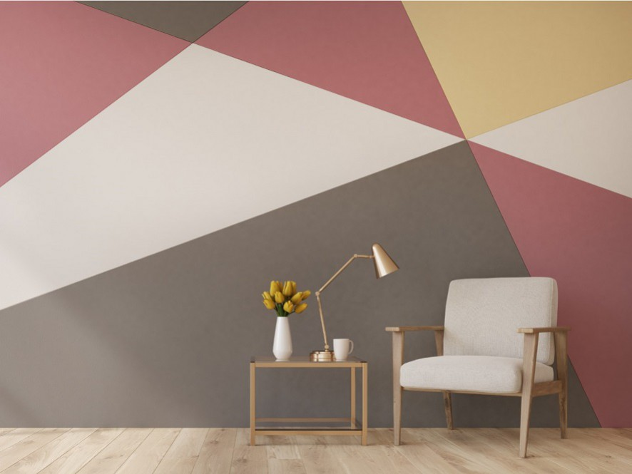 Geometric_print_hallway_soft_pinks_yellows_neutrals_light_timber_floor_table_white_chair_plant