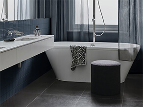 Deep Blue and White Bathroom with Tiles and Marble Counter Top and Sink