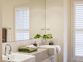 Cream Bathroom with Granite Counter Top and Window and Mirror and Plant and Towel