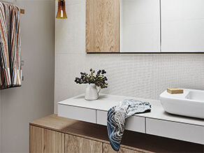 Timber Neutral Bathroom with Brown Wall and Timber Cabinets and Sleek White Basin and Sink
