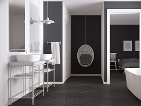 Modern Black and White Bathroom with Wooden Floors and White Sink and Bathtub and towels