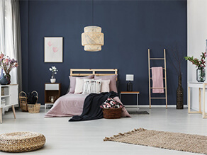 Dark Blue Bedroom Feature Wall with White Floorboards