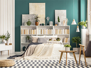 Green Painted Bedroom Wall with Book Case as a Bedhead