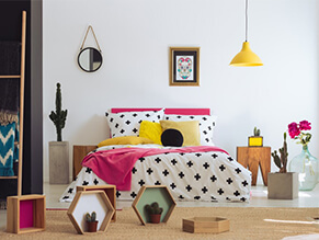 Mexican Fiesta Kids Bedroom with polka dot bed covers and colourful decorations and lamp and plants