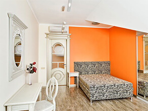 Art Deco Bedroom With Orange Feature Wall