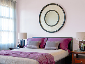 Purple Themed Bedroom With Purple Bed Covers And Circles