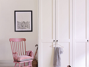 Pink Rocking Chair In A Neutral Bedroom