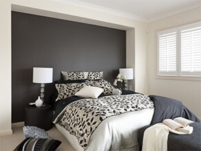 Luxurious Black and White Bedroom with a Matt Black Feature Wall and Black and White Bed Covers