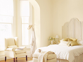 Light Yellow Cream Coloured Bedroom with Light Beige Furniture and Classic Wooden Floorboards