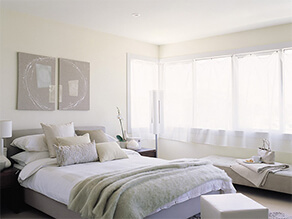 Light White Neutral Themed Greyish Bedroom with Artwork above the bed