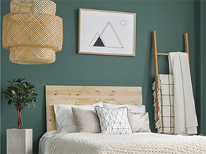 Dark Green Painted Bedroom Wall with Wooden Rack and Art Frame