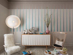 Neutral with blue pop scandi dining room with fur chair and plant with blue stripes on wall
