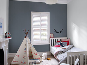 Neutral_grey_kids_room_white_fireplace_indian_tipi_nautical_pillows_blanket_white_bedframe_rug