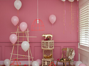 Pink_kids_room_nursery_gold_leaf_pig_ornament_balloons_timber_pole_tower_red_light_cage_tan_crate