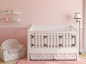 Pretty_in_Pink_Nursery_White_Cot_Ribbons_Polka_Dot_Chair_White_Shelves_timber_Lamp_Fluffy_Rug