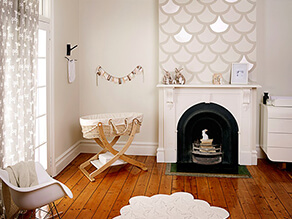 Timber_themed_natural_nursery_cane_cot_fireplace_rug_white__giraffe_curtains_fish_scale_artwork