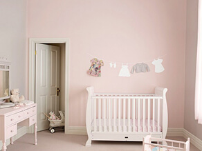 pink_nursery_feature_wall_cream_door_clothesline_artwork_white_cot_pink_carpet_dressing_table
