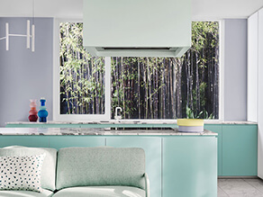 Escapade_soft_green_kitchen_purple_feature_wall_green_couch_marble_countertop_bamboo_window
