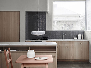 Essential_kitchen_dark_grey_textured_splashback_painted_concrete_wall_marble_countertop_timber