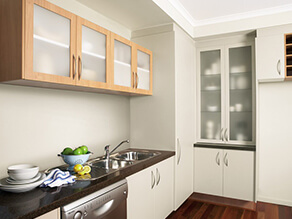 Neutral_kitchen_timber_white_cabinets_stainless_steel_sink_stone_countertop_white_timber_floor