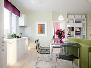 Pastel_Green_Kitchen_White_countertop_cabinets_clear_grey_table_chairs_pink_flowers_couch