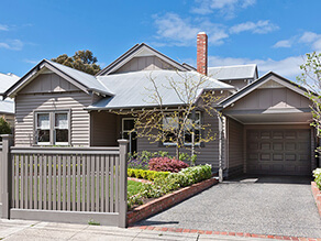 Neutral Weatherboard with Grey Window Trims and Front Garden and Concrete Driveway and Grey Garage